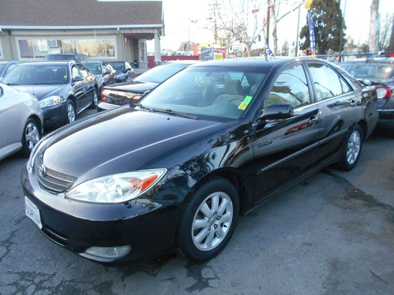 2003 TOYOTA CAMRY XLE 4DR SEDAN black abs - 4-wheel anti-theft system - alarm cassette center