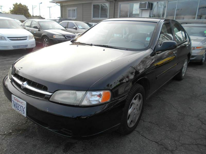 1998 NISSAN ALTIMA GXE 4DR SEDAN black cassette center console cruise control exterior entry l