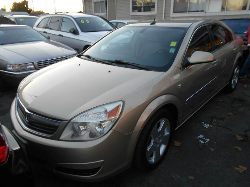 2007 SATURN AURA XE 4DR SEDAN gold 2-stage unlocking - remote abs - 4-wheel airbag deactivation