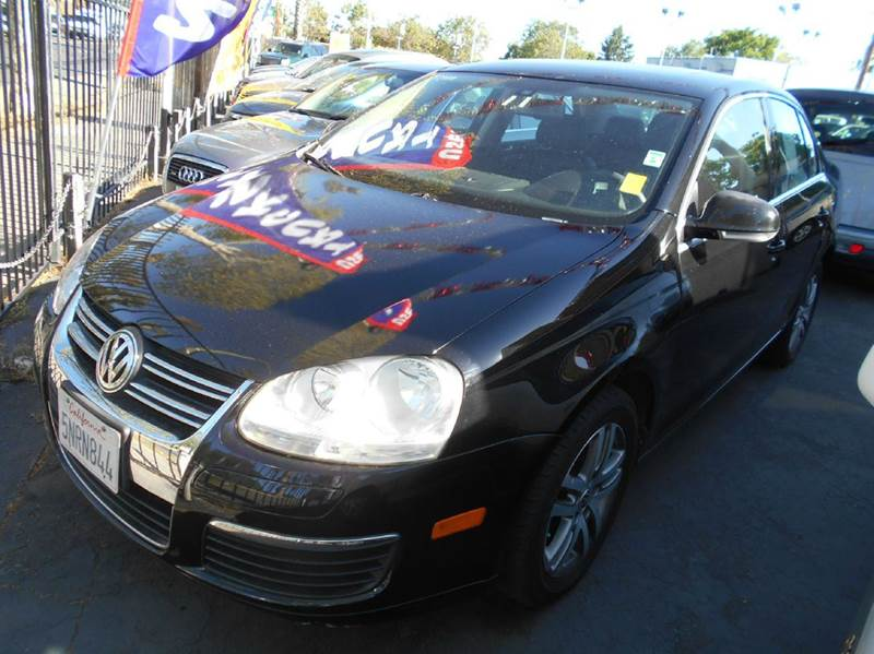 2005 VOLKSWAGEN JETTA 25 PZEV NEW 4DR SEDAN black abs - 4-wheel anti-theft system - alarm cent