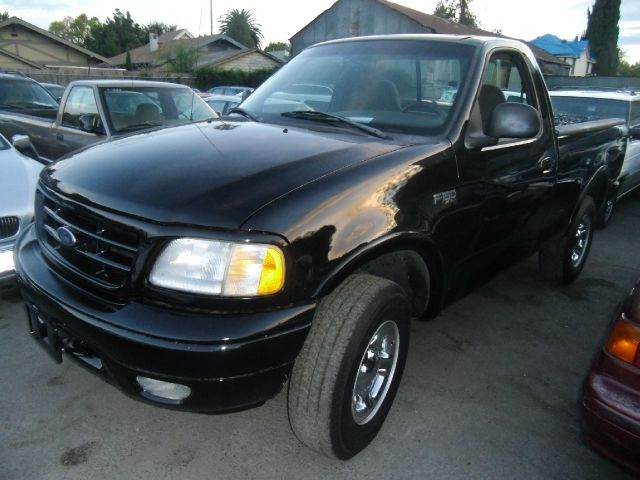1999 FORD F-150 XL 2DR 4WD STANDARD CAB SB black abs - rear-only bumper color - chrome front air