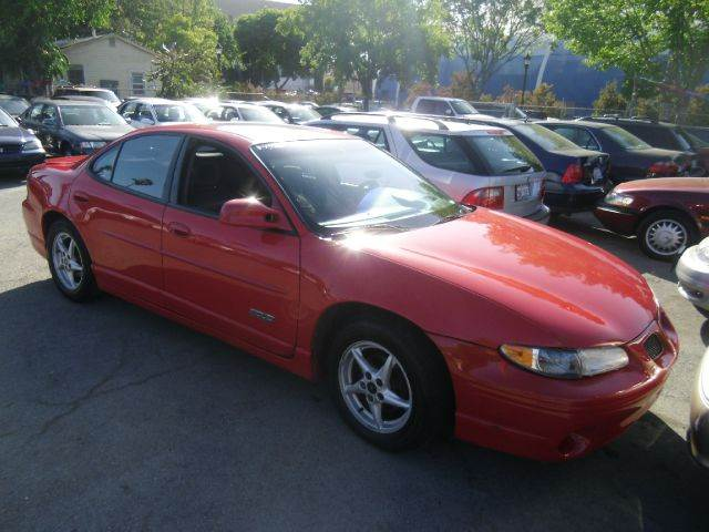 1999 PONTIAC GRAND PRIX GTP 4DR SUPERCHARGED SEDAN red 16 inch wheels abs - 4-wheel alloy wheels
