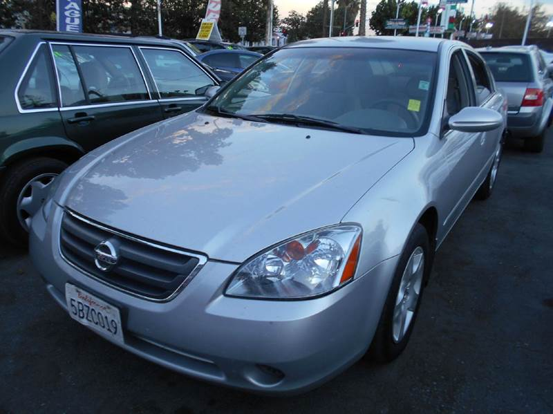 2003 NISSAN ALTIMA 25 4DR SEDAN silver center console exterior entry lights front airbags - du