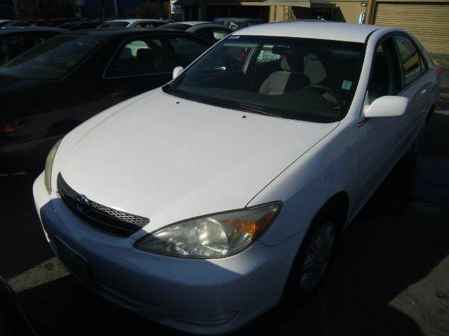 2003 TOYOTA CAMRY LE 4DR SEDAN white cassette center console clock cruise control daytime runn