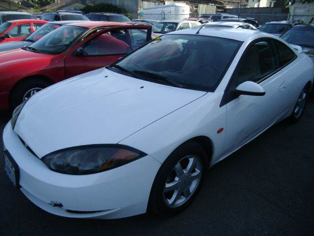1999 MERCURY COUGAR white 2 doorair conditioningalloy wheelsamfm radioautomatic transmission