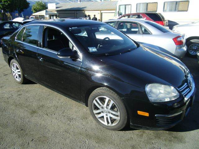 2006 VOLKSWAGEN JETTA 25L black abs brakesair conditioningalloy wheelsamfm radioanti-brake s