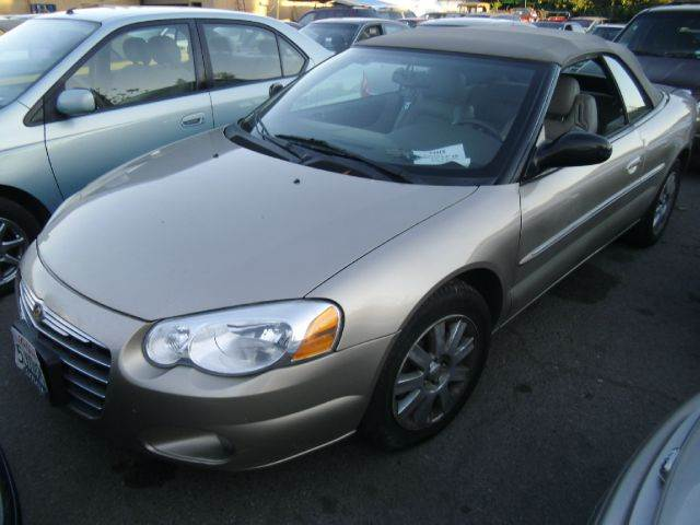 2004 CHRYSLER SEBRING LIMITED CONVERTIBLE gold air conditioningalloy wheelsamfm radioanti-bra