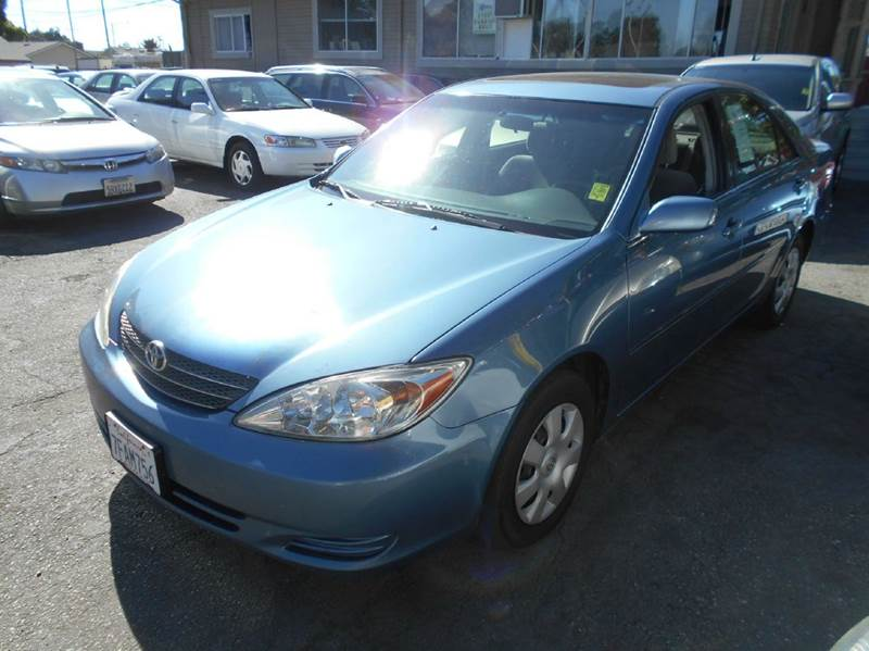 2004 TOYOTA CAMRY LE 4DR SEDAN blue cassette center console clock cruise control daytime runn
