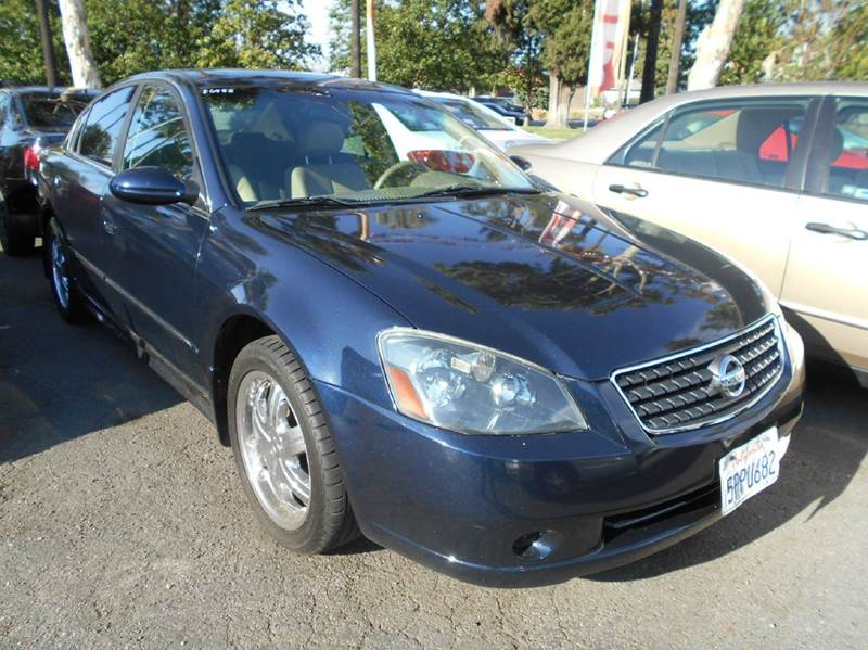 2005 NISSAN ALTIMA 25 S 4DR SEDAN blue center console - front console with storage clock cruis