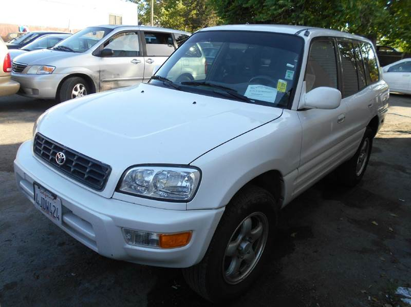 2000 TOYOTA RAV4 BASE 4DR SUV white center console front airbags - dual front seat type - bucke