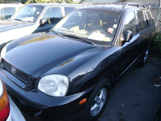 2004 HYUNDAI SANTA FE black 2 wheel drive4 doorair conditioningamfm radioautomatic transmiss