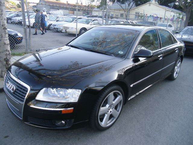 2006 AUDI A8 SEDAN black 4wdawdabs brakesair conditioningalloy wheelsamfm radioanti-brake s