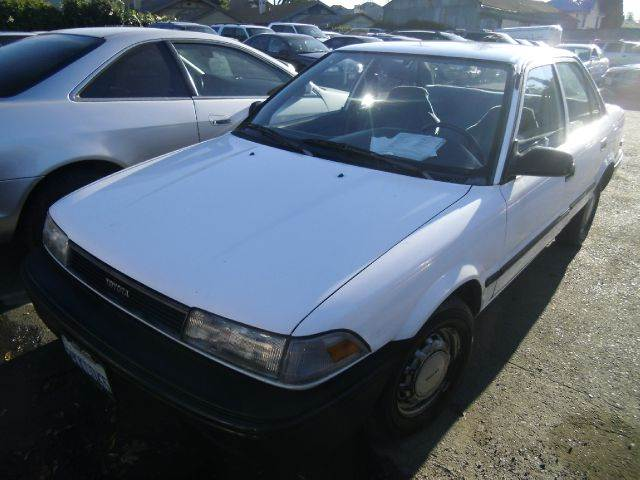1988 TOYOTA COROLLA DLX white anti-brake system non-absbody style sedan 4-drcurb weight-manual