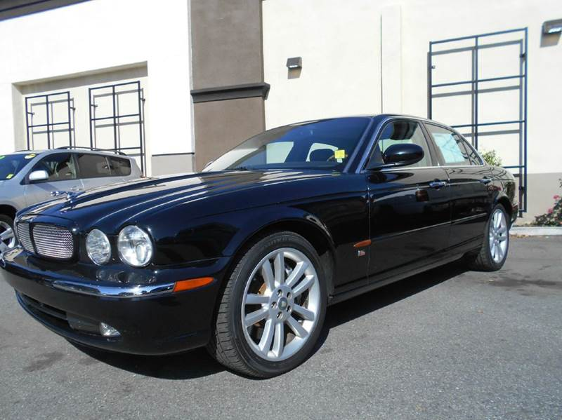 2004 JAGUAR XJR BASE 4DR SUPERCHARGED SEDAN black abs - 4-wheel adjustable pedals - power air s