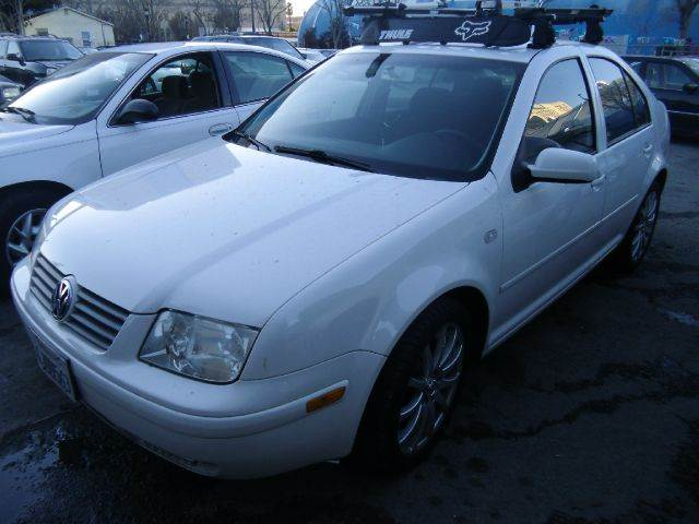 2000 VOLKSWAGEN JETTA white 4 doorair conditioningamfm radiocruise controldriver air bagmanu
