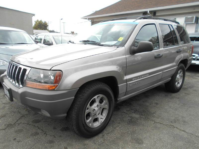 1999 JEEP GRAND CHEROKEE LAREDO 4DR 4WD SUV silver abs - 4-wheel cassette center console cruis
