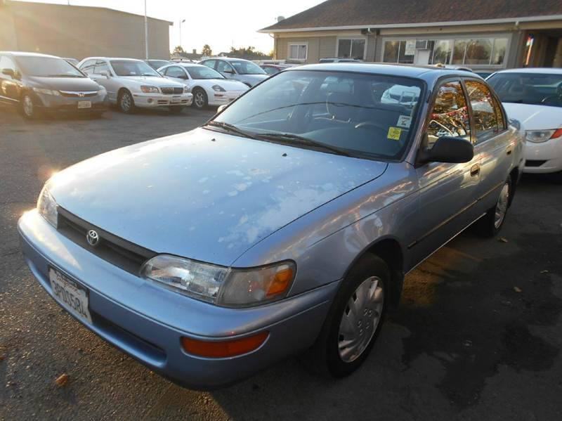1995 TOYOTA COROLLA DX 4DR SEDAN blue center console clock front airbags - dual front seat typ