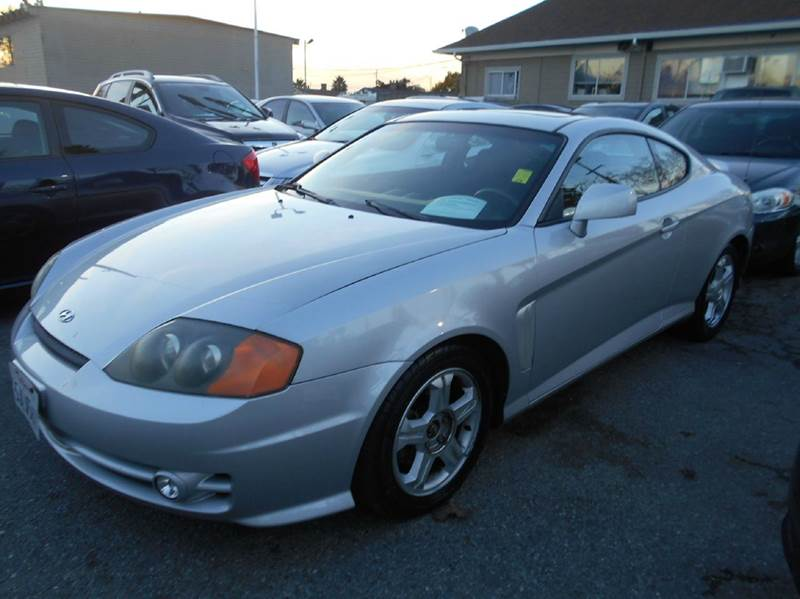 2004 HYUNDAI TIBURON BASE 2DR HATCHBACK silver anti-theft system - alarm center console clock