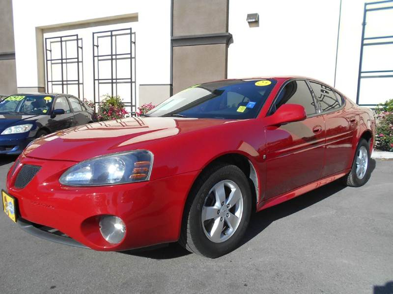 2007 PONTIAC GRAND PRIX BASE 4DR SEDAN red 2-stage unlocking doors air filtration antenna type