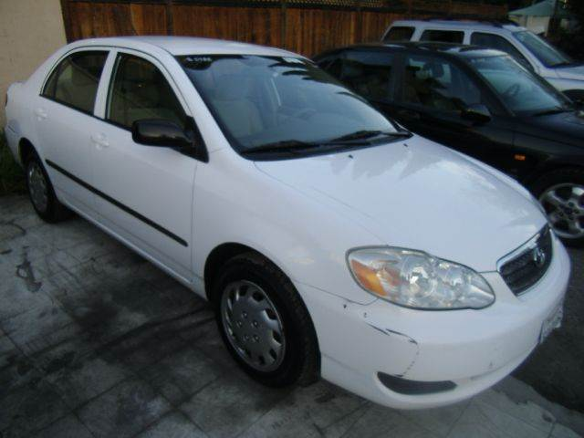 2006 TOYOTA COROLLA CE 4DR SEDAN 18L I4 4A white air filtration antenna type anti-theft syst