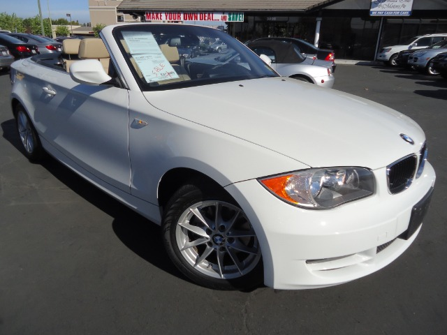 2011 BMW 1 SERIES alpine white the rear-wheel drive   convertible the 128i is powered by a 230-hp