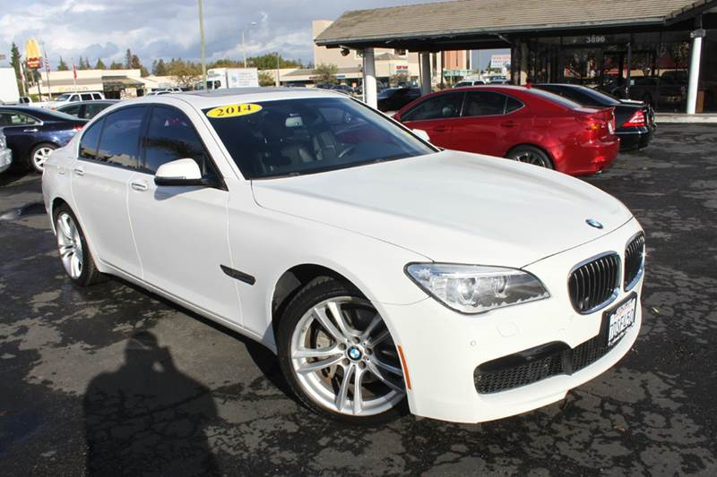 2014 BMW 7 SERIES 740I 4DR SEDAN white this bmw truly is the ultimate driving machinethis car is