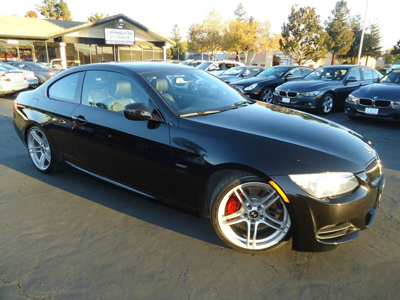 2012 BMW 3 SERIES 335IS 2DR COUPE black fully loaded come with the remainder of the factory wa