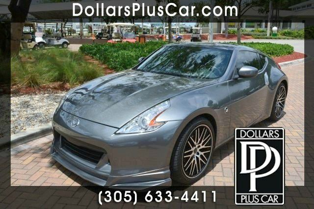 2012 NISSAN 370Z 370Z TOURING COUPE silver dollars plus car truly has the best prices   average m