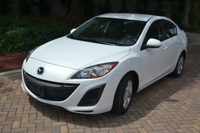 2011 MAZDA 3 I TOURING 4-DOOR white we have financing available for all yours financial needs  yo