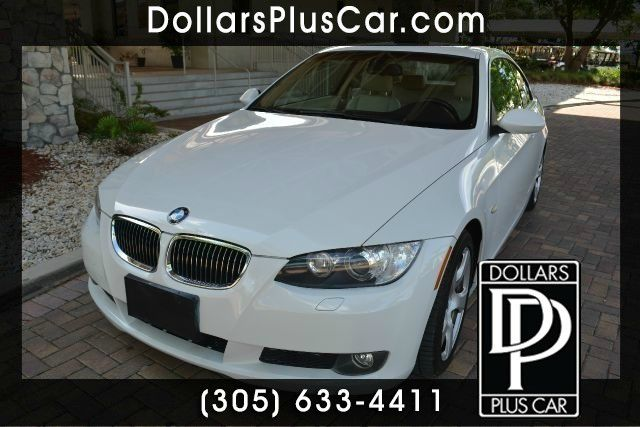 2009 BMW 3 SERIES 328I 2DR COUPE white dollars plus car truly has the best prices   average marke