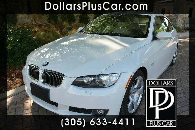 2009 BMW 3 SERIES 328I 2DR COUPE white dollars plus car truly has the best prices     market pric