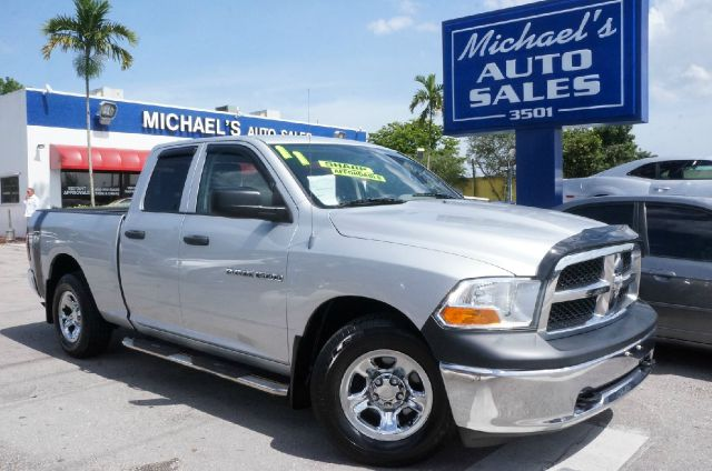 2011 RAM RAM PICKUP 1500 SLT 4X2 4DR QUAD CAB 63 FT SB bright silver metallic clearco 99 point