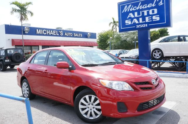 2012 TOYOTA COROLLA LE 4-SPEED AT barcelona red metallic call now 1-866-717-9571  free autocheck