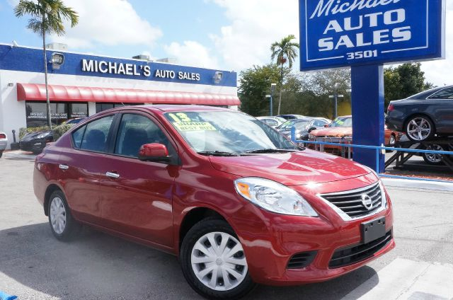 2013 NISSAN VERSA 16 SV red brick 99 point safety inspection automatic and clean carf