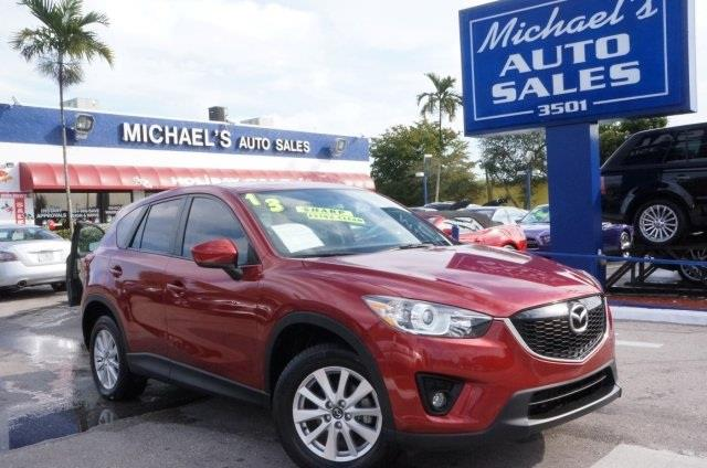 2013 MAZDA CX-5 TOURING 4DR SUV zeal red mica red hot your lucky day are you interested in a s