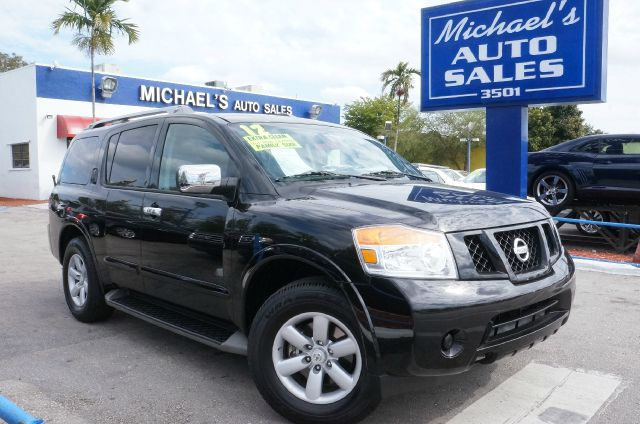 2012 NISSAN ARMADA SV galaxy black 99 point safety inspection and clean carfax drive this