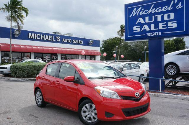 2012 TOYOTA YARIS L 5-DOOR AT absolutely red abs brakesair conditioningamfm radiocargo area co