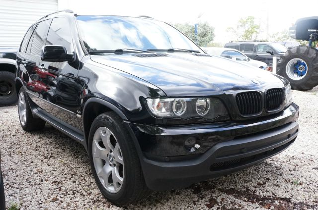 2001 BMW X5 44 unspecified front bucket seatsleather upholsterycd holder4-wheel disc brakesai