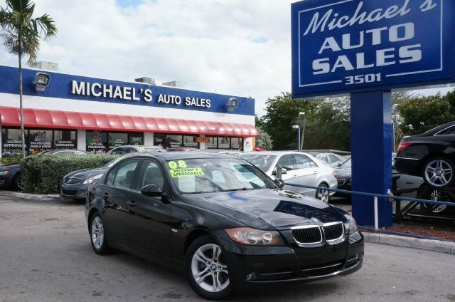 2008 BMW 3 SERIES 328I jet black pampering you all the way from alpha to bravo an ideal ride for