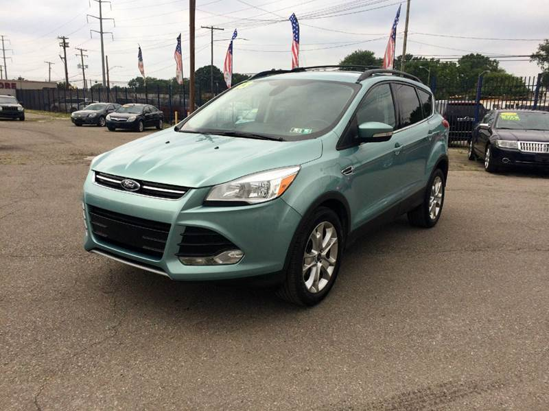 2013 Ford Escape  Miles 76888Color Teal Stock 228F VIN 1FMCU0HX0DUD56588