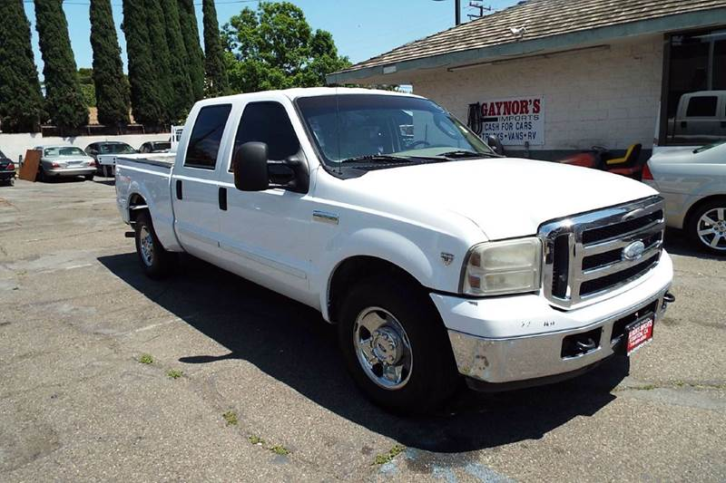 2006 FORD F-250 SUPER DUTY XLT 4DR CREW CAB SB white this is good a good running work truck cab a