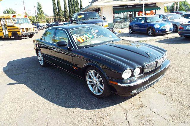 2004 JAGUAR XJR BASE 4DR SEDAN grey abs - 4-wheel adjustable pedals - power alloy wheels anti-