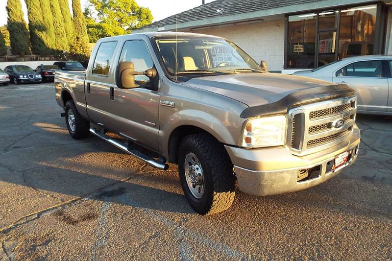 2005 FORD F-250 SUPER DUTY XLT 4DR CREW CAB RWD SB bronze this is a one owner low mile crew cab t