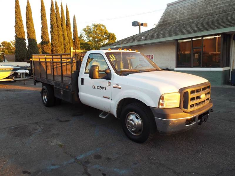 2006 FORD F-350 XL white 11 foot steel flat bed with fixed sides and tommy lift turbo diesel 218