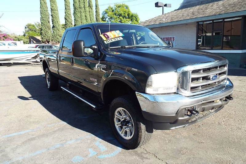 2004 FORD F-350 SUPER DUTY LARIAT 4DR CREW CAB 4WD LB dark green abs - 4-wheel anti-theft system