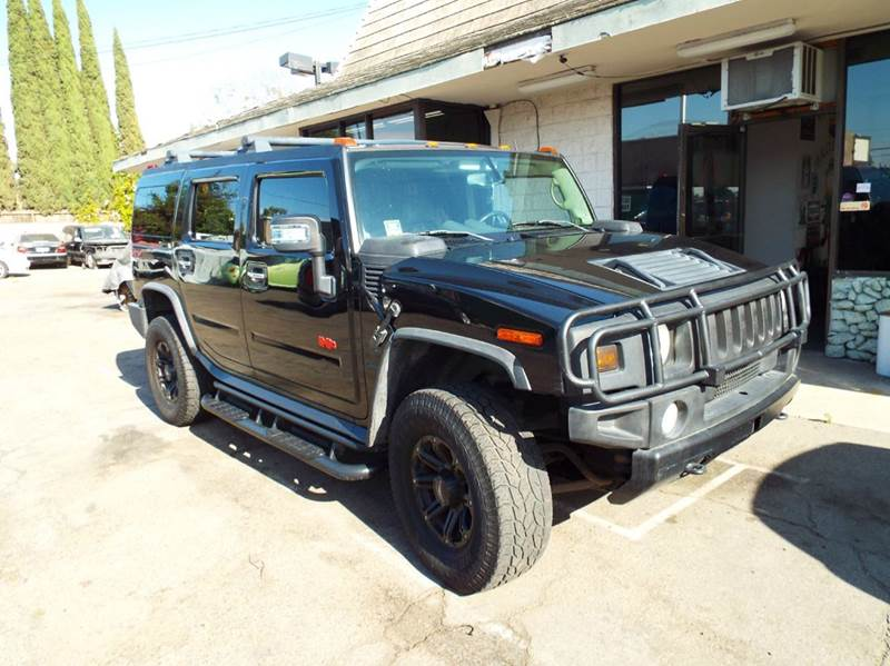 2003 HUMMER H2 ADVENTURE SERIES 4DR 4WD SUV black front brush bar side step bars inside spare w