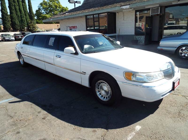 1999 LINCOLN TOWN CAR white 1999 lincoln town car 70 inch stretch limo 5 door 7 passenger priced