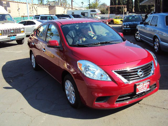 2012 NISSAN VERSA 16 SV SEDAN red traction control included power steering included vehicle dynam