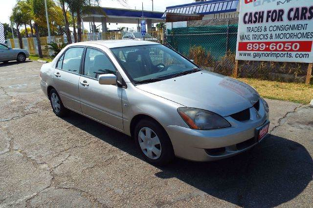 2005 MITSUBISHI LANCER ES 4DR SEDAN gold this is a nice low mile gas friendly transportation car