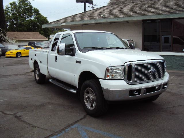 2006 FORD F250 LARIAT SUPERCAB LONG BED 4WD white this is a 2006 ford f250 4 wheel drive 4 door ex